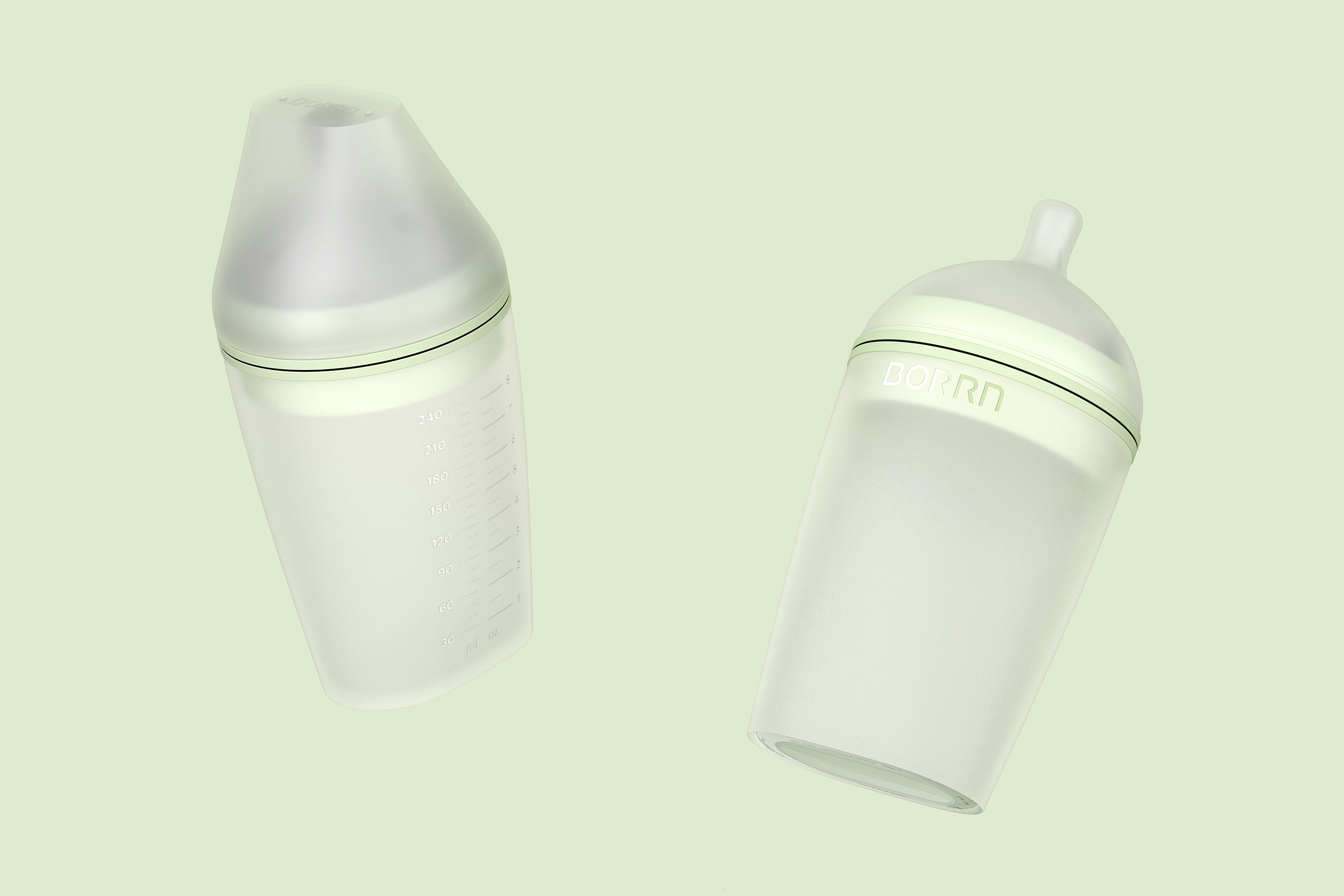 Perspective view of two large Borrn Bottles in green against a green background. One of the bottles had a lid on and shows the capacity markings, the other shows the teat and Borrn logo.