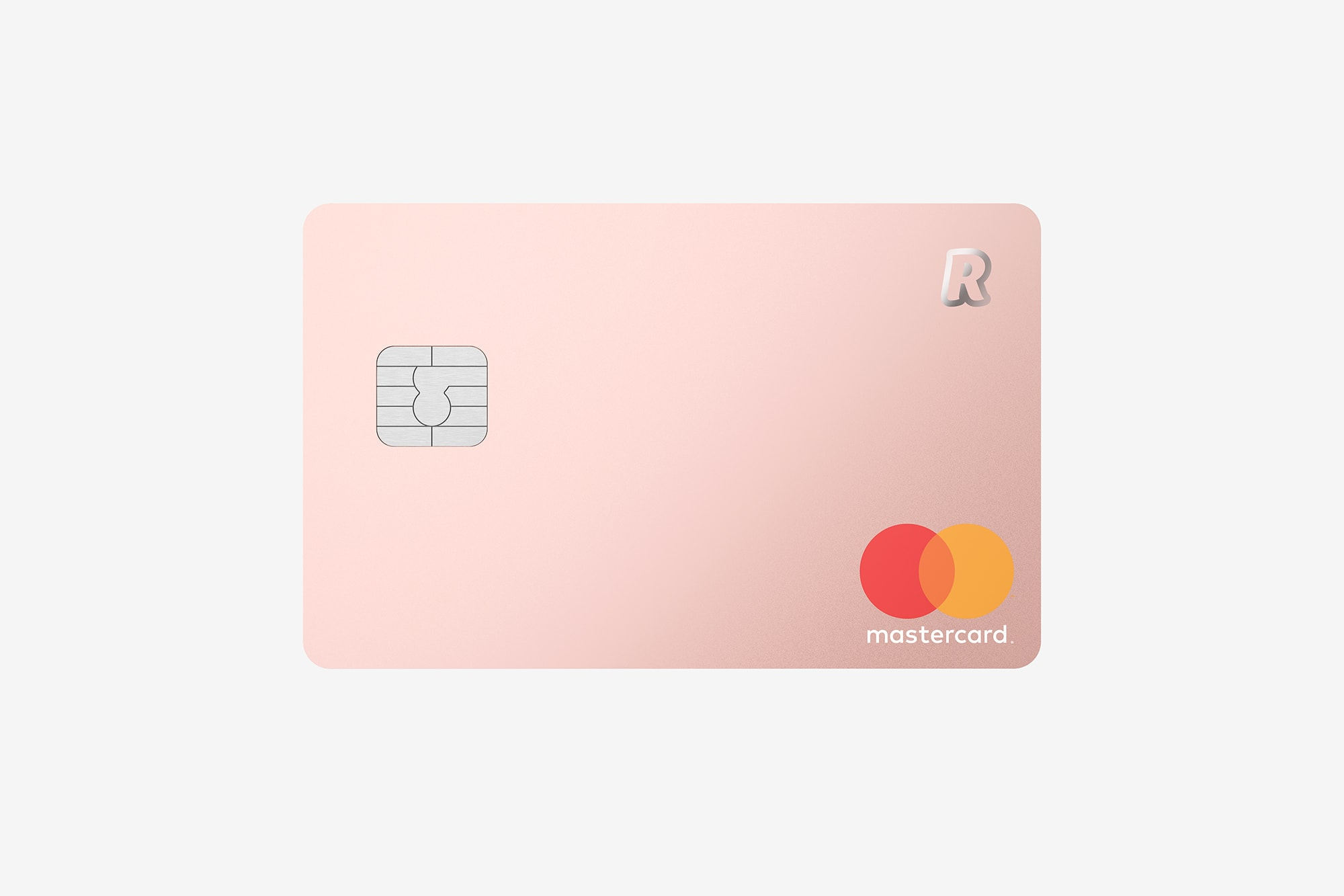 Front view of the Revolut Premium Bank Card showing a silver chip, a mastercard logo and Revolut logo, metallic pink.
