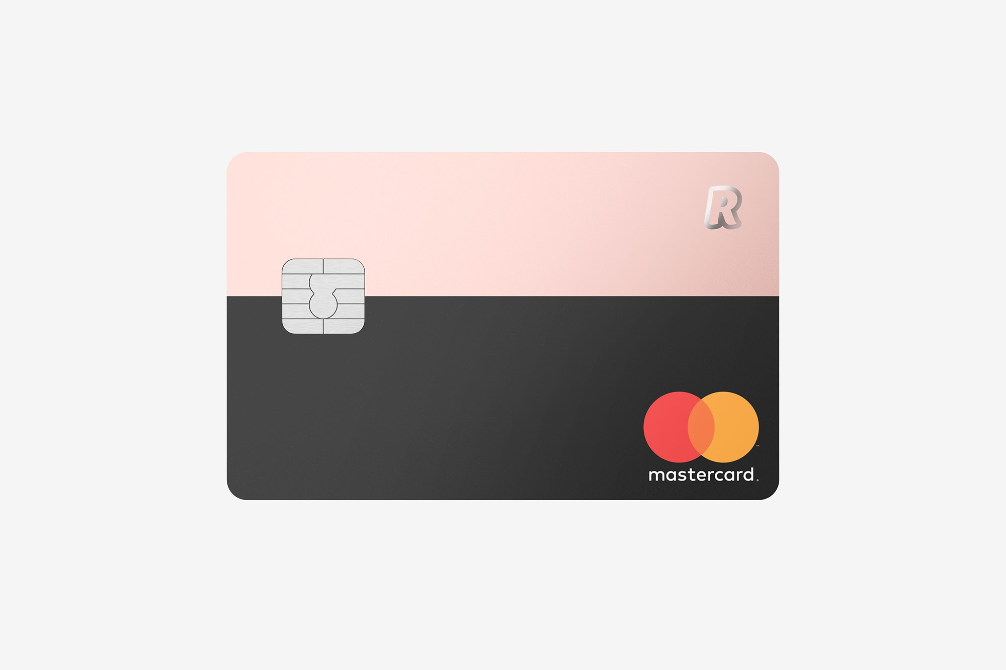Front view of the Revolut Premium Bank Card showing a silver chip, a mastercard logo and Revolut logo, metallic pink and black.
