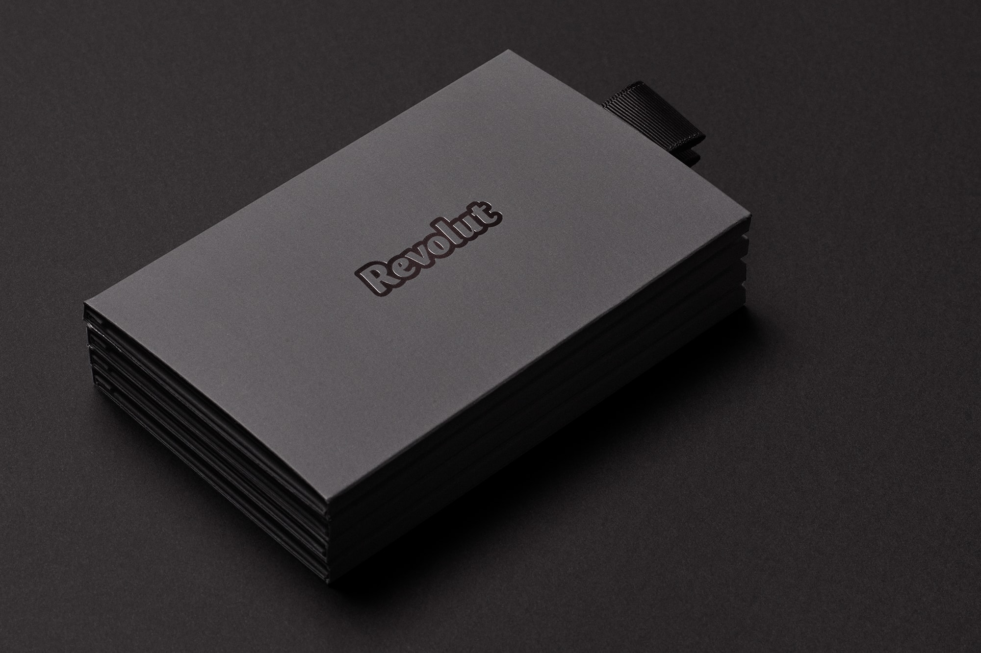 Perspective view of Revolut Premium bank card packaging in black with the revolut logo shown on a black background.