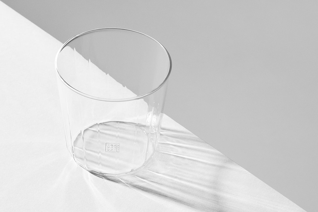 Rivington Glassware tumbler on the edge of a white surface casting a shadow.