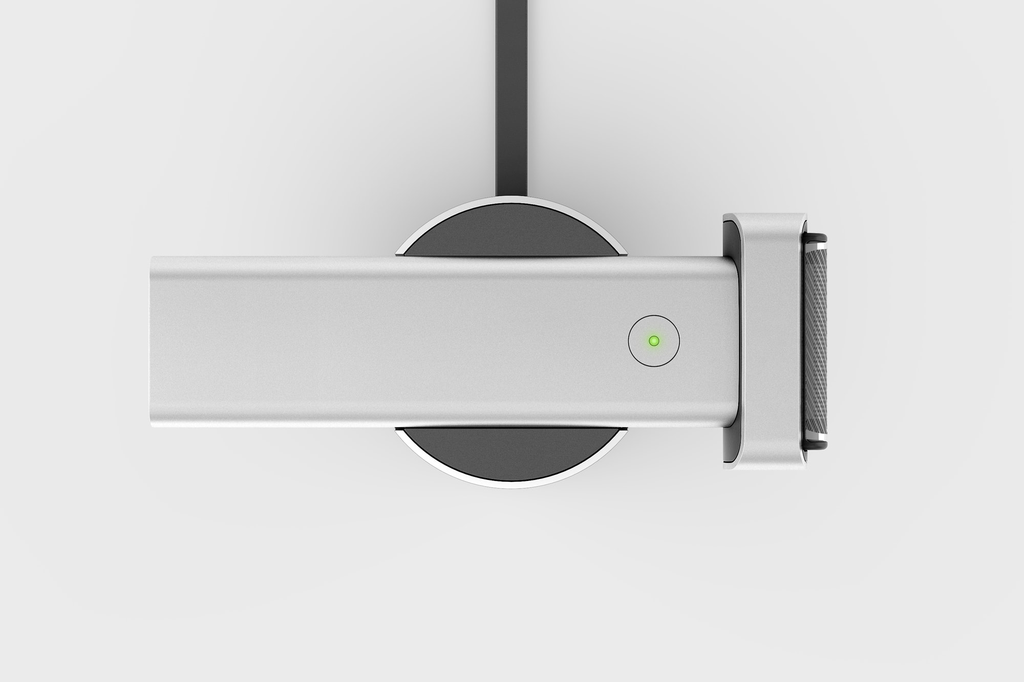 Top view of the Extrusion shaver charging in wireless charging dock, shown in the silver colourway.