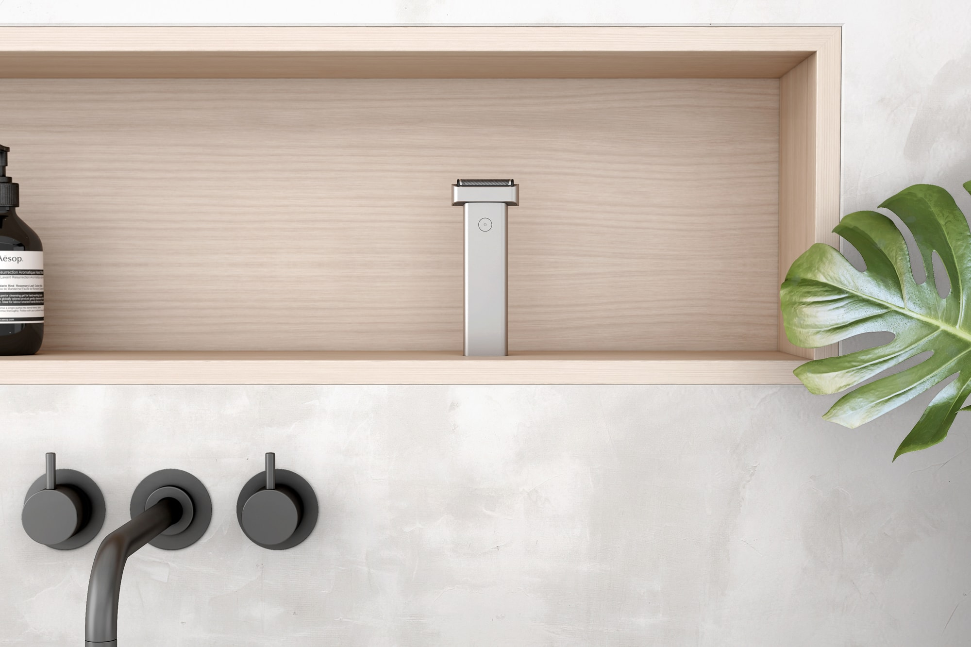 Front view of the Extrusion shaver on a wooden shelf in a bathroom.