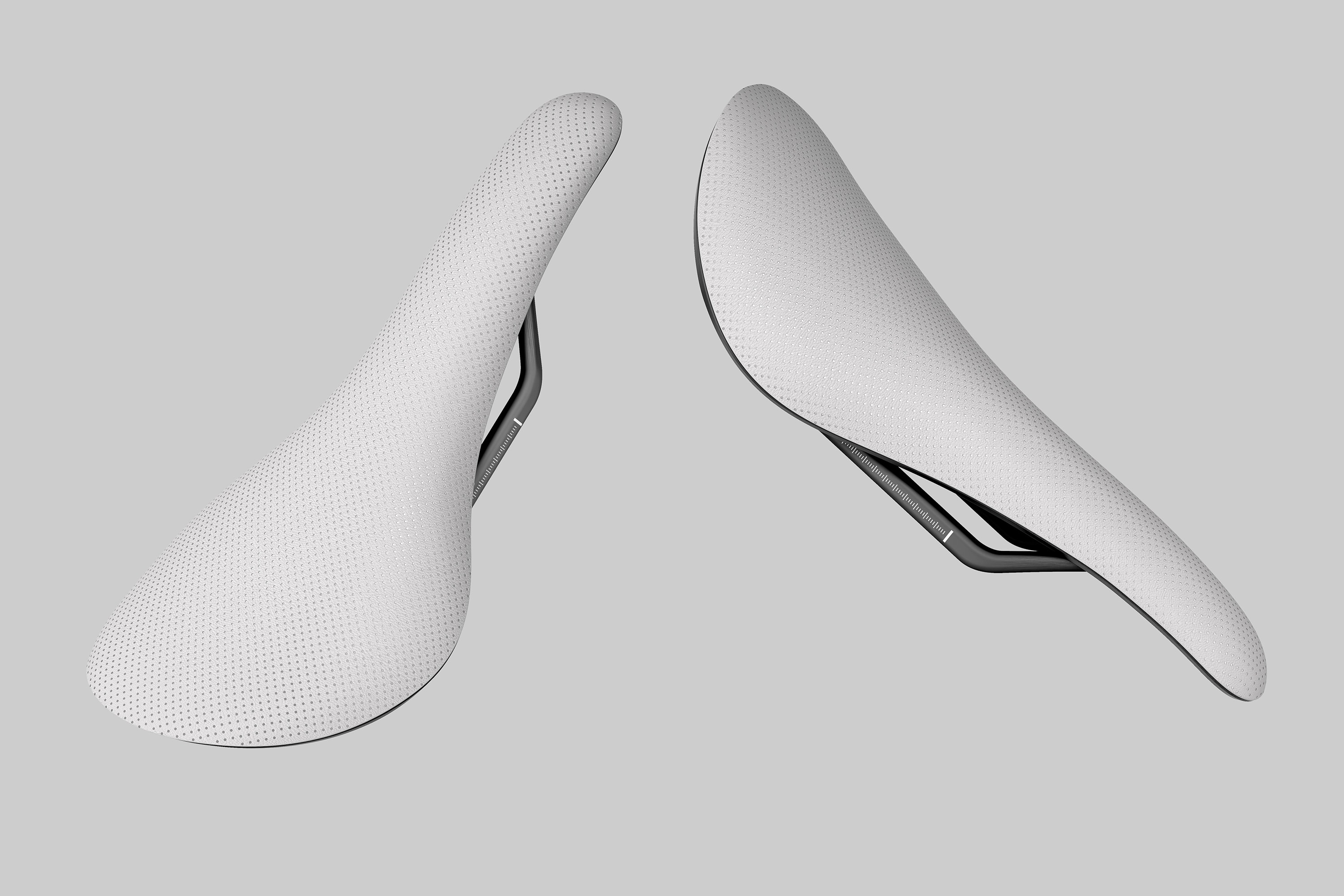 Perspective view of two Rapha Saddles floating against a light grey background. The image shows the top of the saddles.