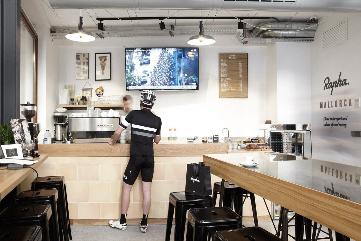 Rapha clubhouse, cased inside a wooden table is a topographical map centrepiece showing cycling routes in Mallorca made of extruded Valchromat steps.