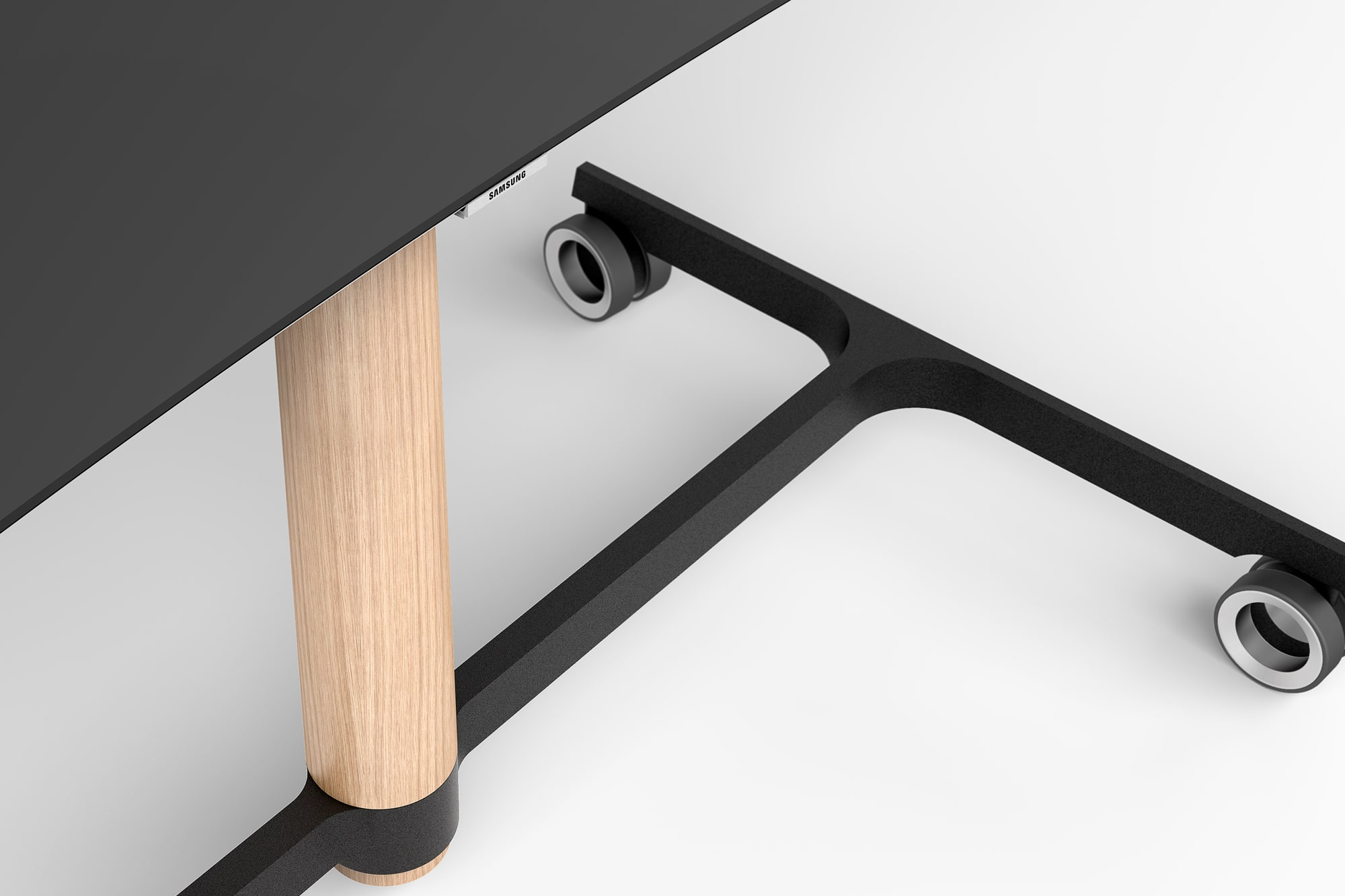 Detail view of a light wood leg and a black base in use.
