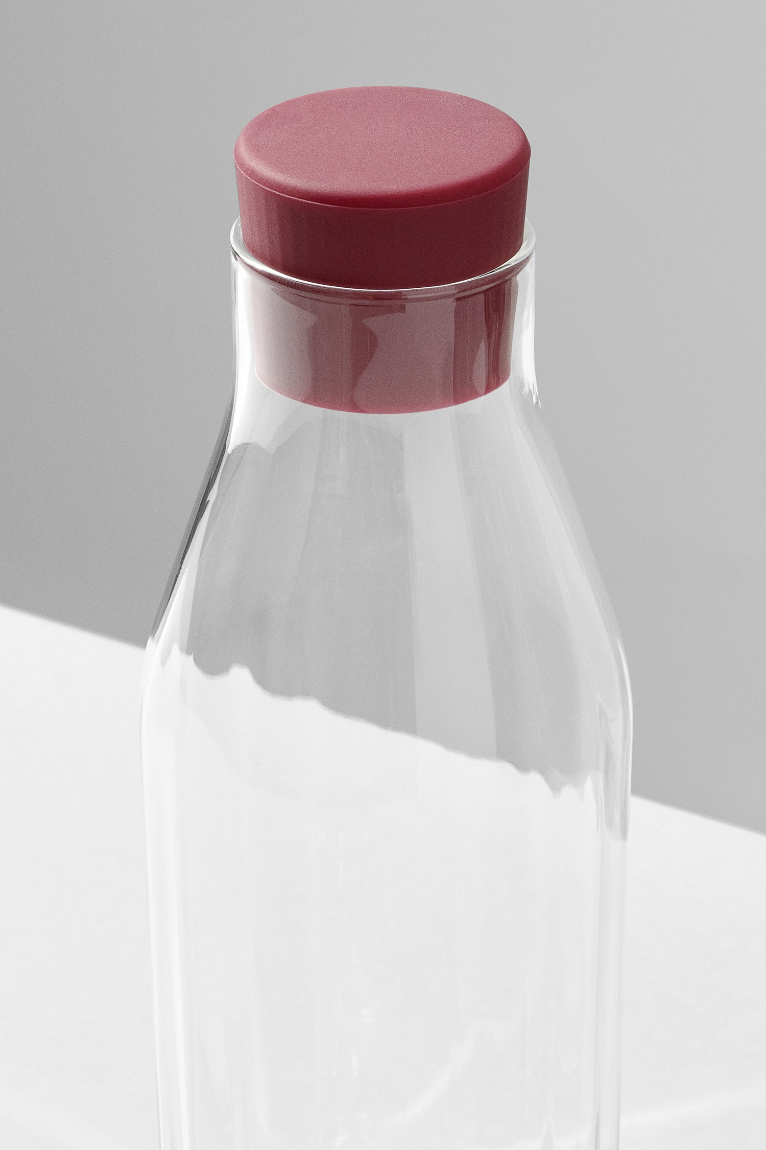 Perspective view of the top of the Rivington Glassware carafe showing the facets, red stopper.