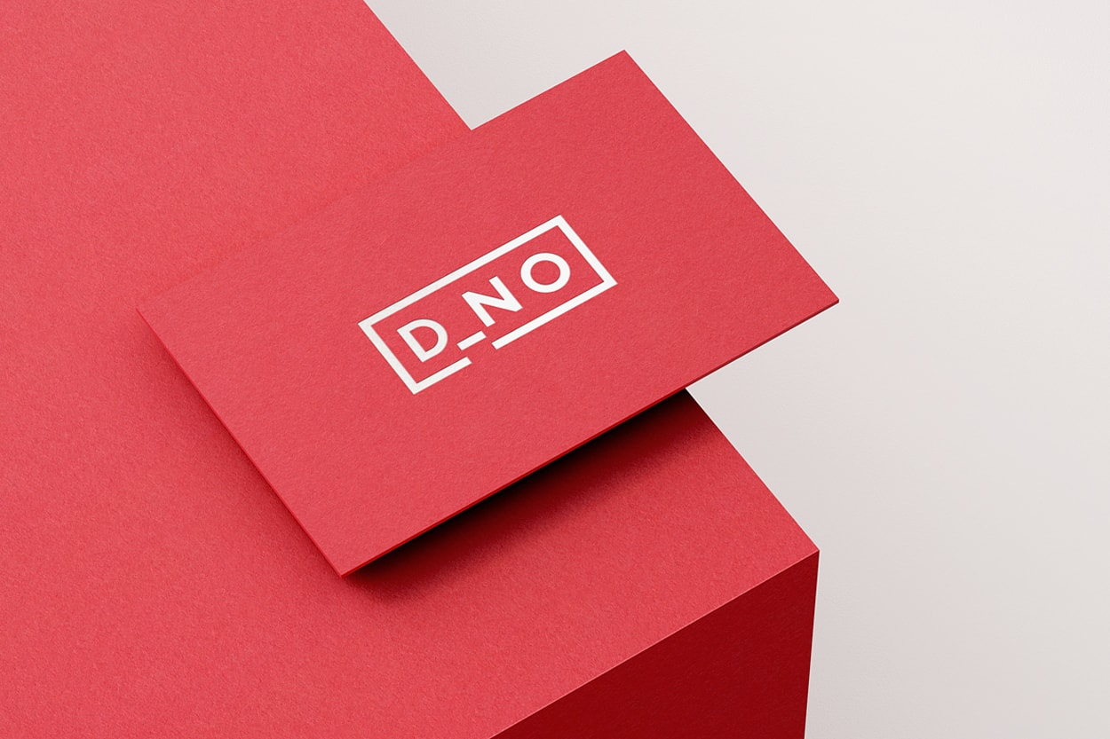 DNO logo shown on a red business card on a red surface.