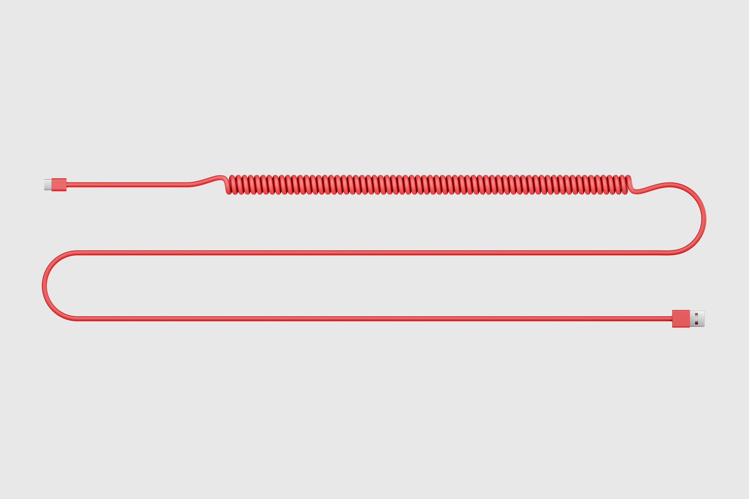 Top view of red spiralled power cable for the DADI Node One,on a grey background.