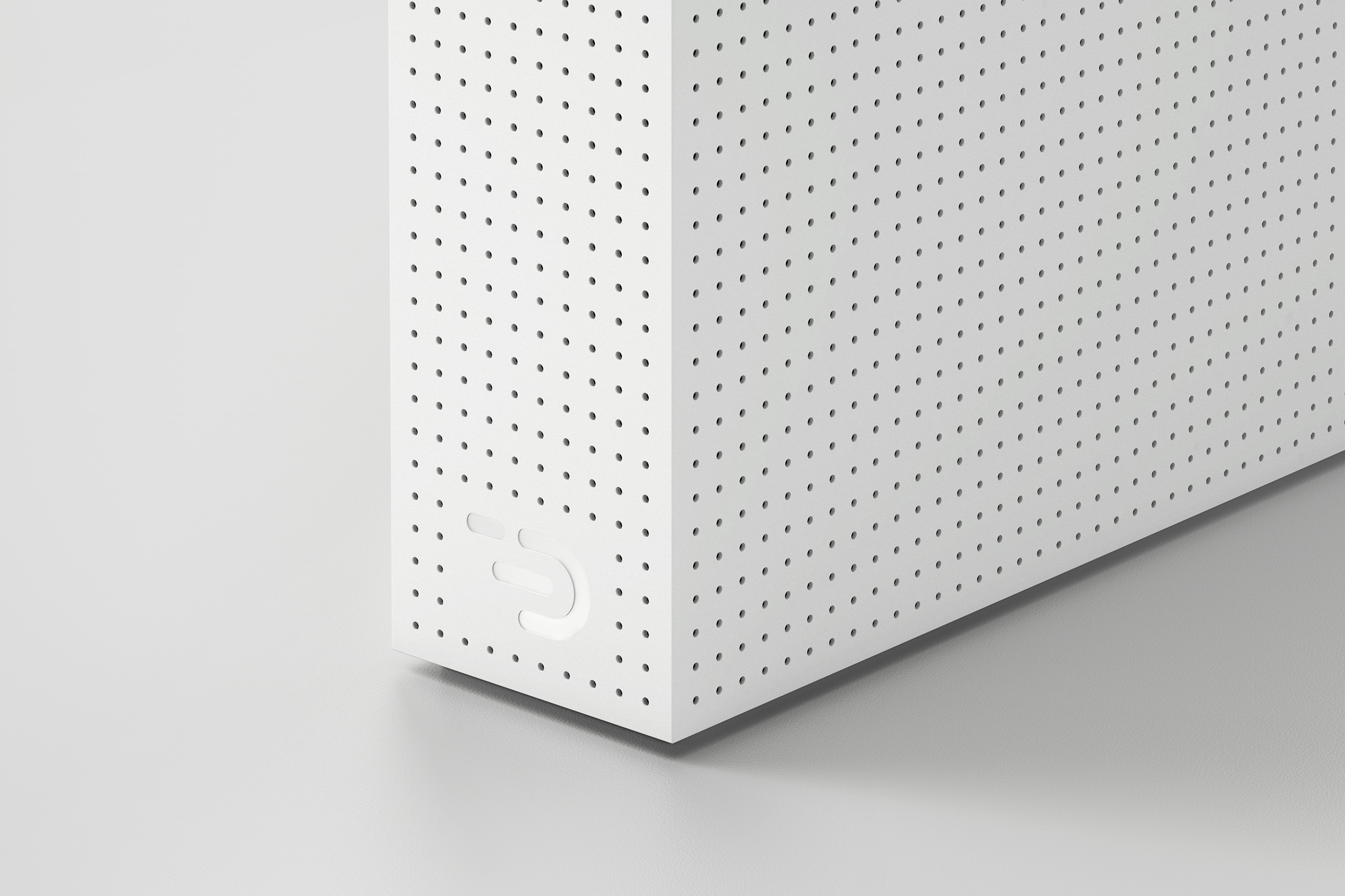 Perspective view of part of the Node one in white. The casing is perforated with small holes for venting and shows the DADI logo.