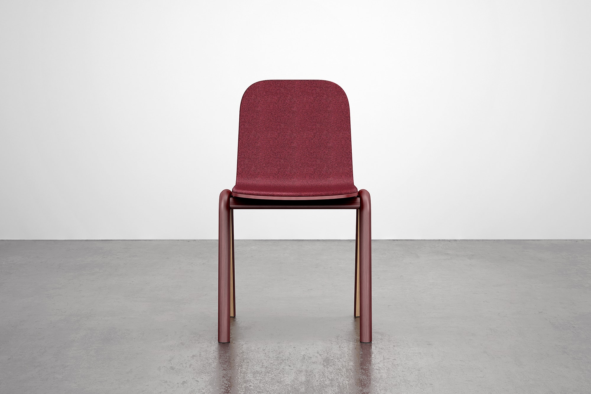 Front view of Burgundy Chair with cushion. The chair is made using steam bent wood.