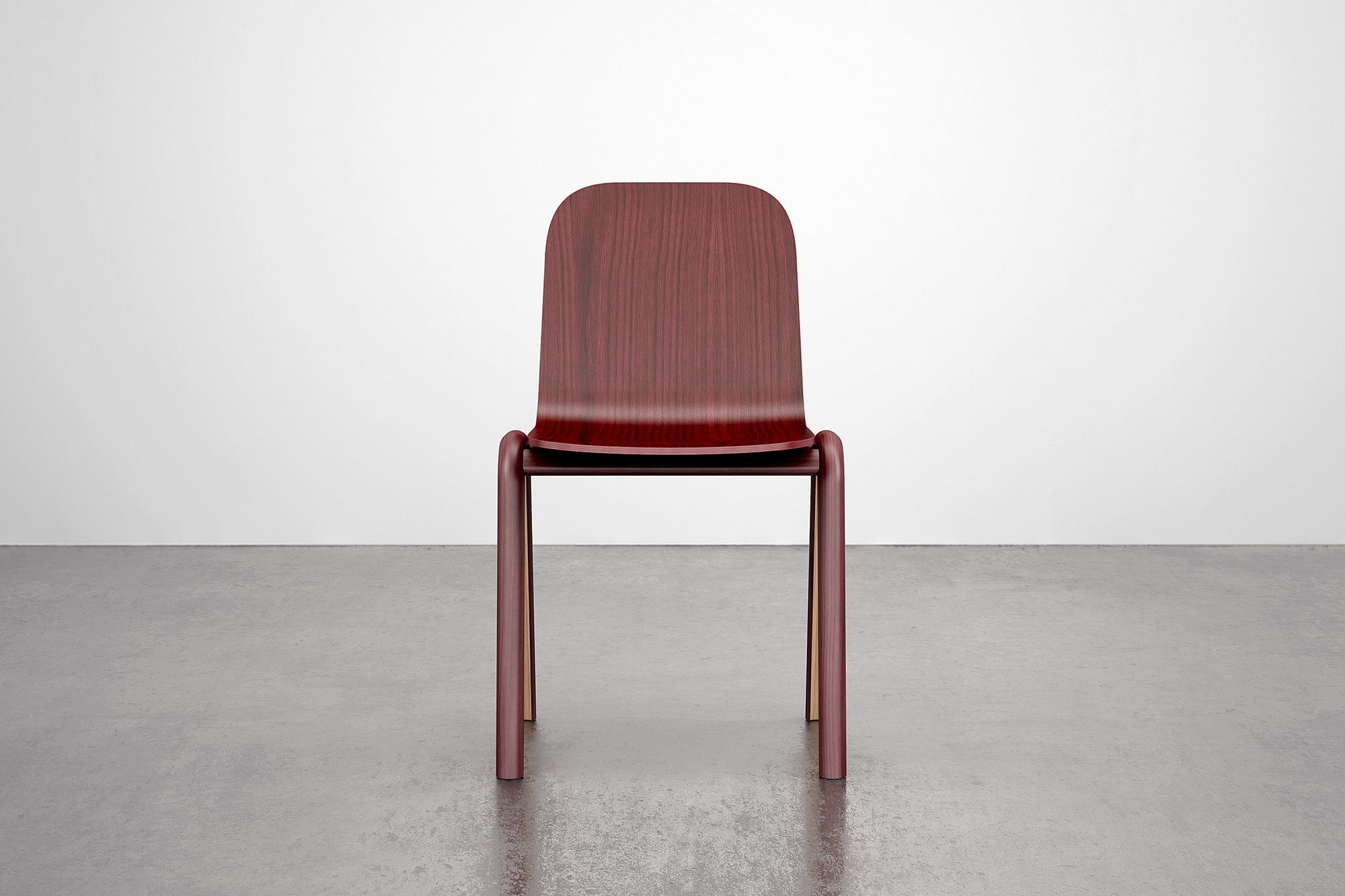 Front view of Burgundy Chair. The chair is made using steam bent wood.