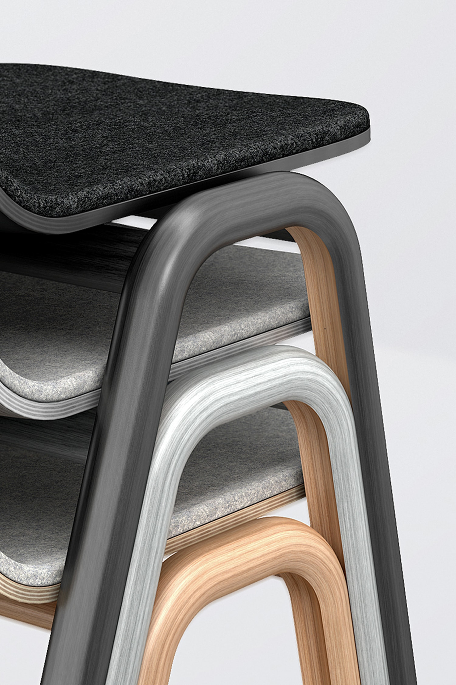 Detail view of Grey, Oak and Black Chairs. The chairs are made using steam bent wood. The image is cropped and draws the attention to the legs and how they are designed to be easily stacked.