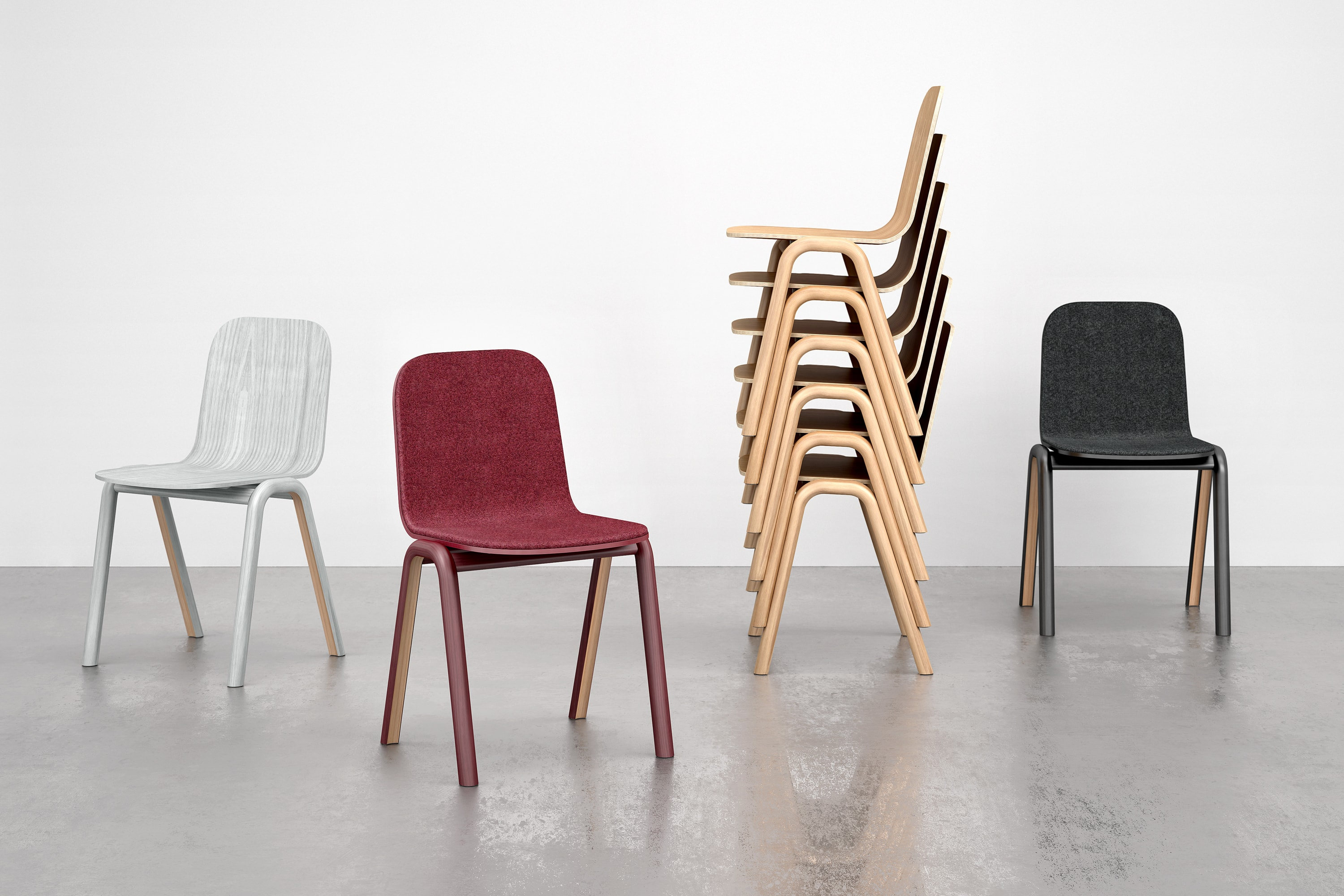 Grey, Burgundy and Black Chairs arranged in different angles. The chairs are made using steam bent wood. There are also several wooden chairs stacked in order to show the function.