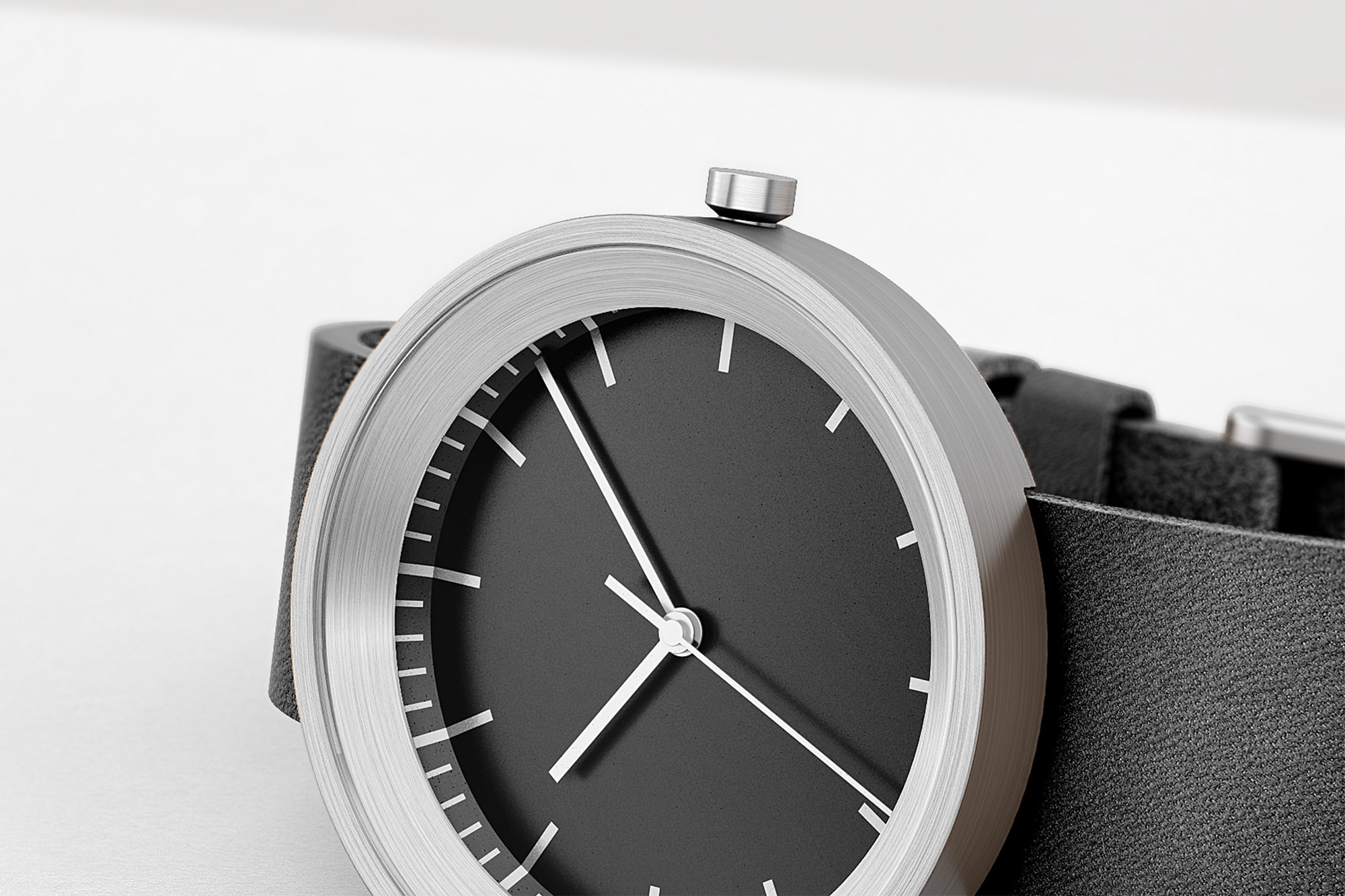 Close up of Hide watch with black strap and silver face