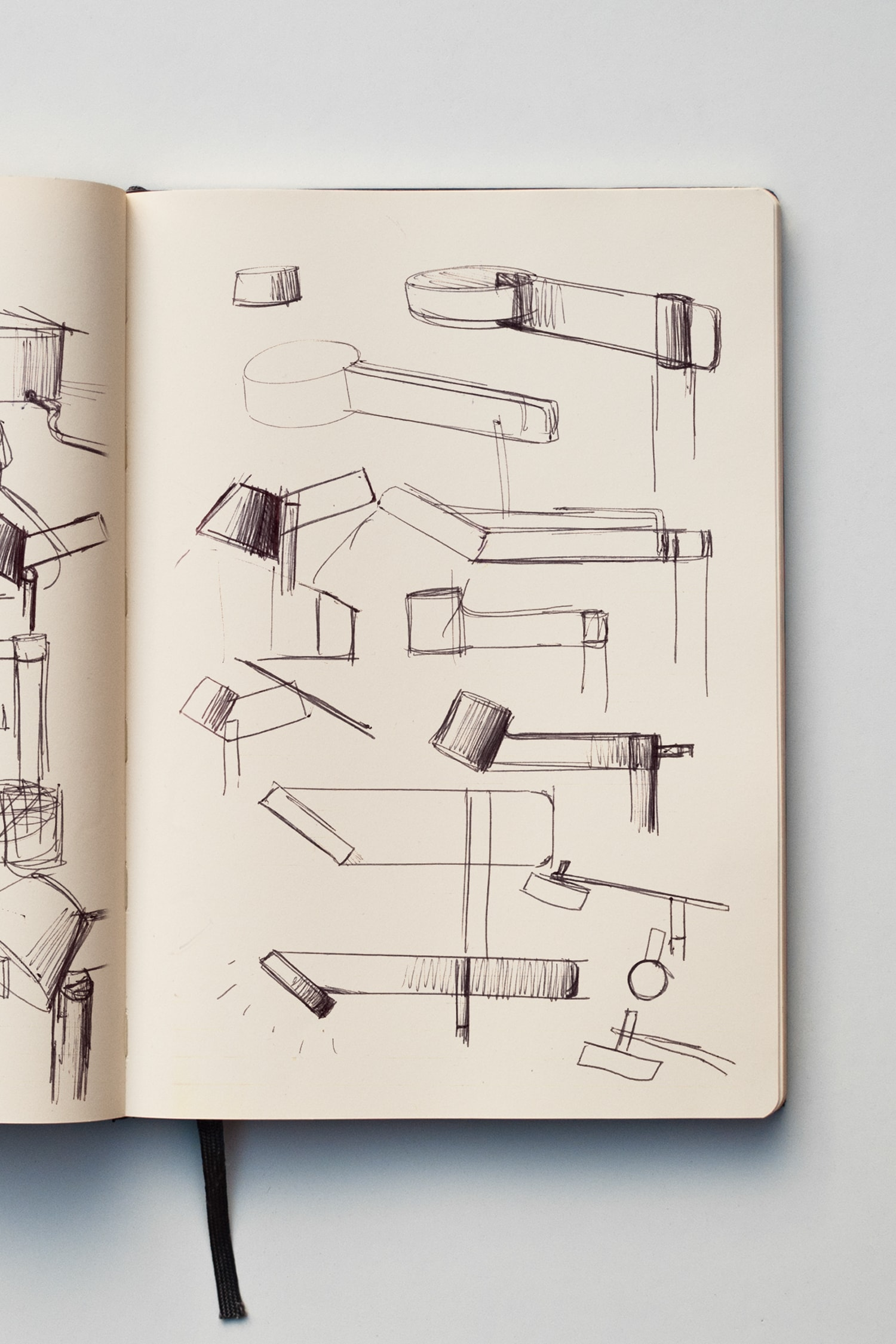 A notebook with some quick sketches of a lamp.